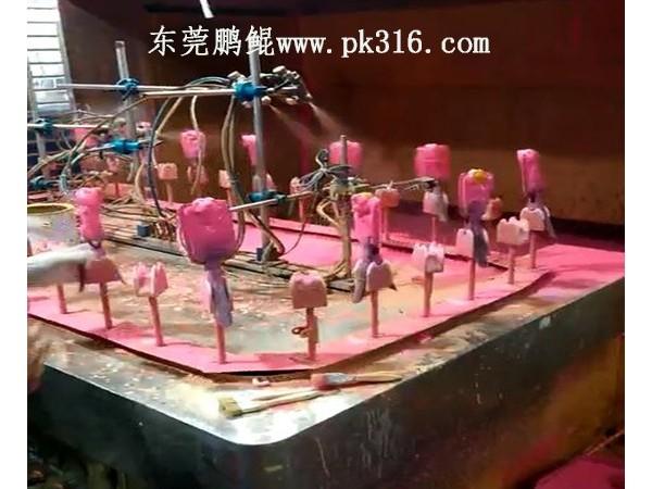 东莞塑胶玩具喷油机和手工喷漆的对比